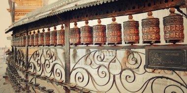 Tibetan Prayer Wheels with mantras near Swayambhunath Stupa - vintage photo.