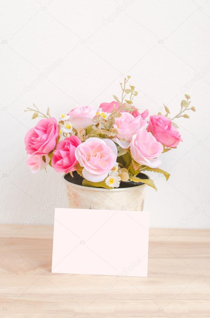 Pastel Artificial Pink Rose In Flower Pot And White Paper Card