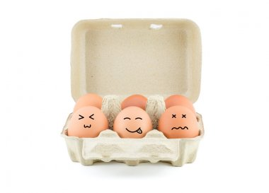 Funny Drawing Faces on Eggs in carton isolate on white with clipping path stock vector