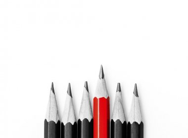 One red pencil standing out from the row