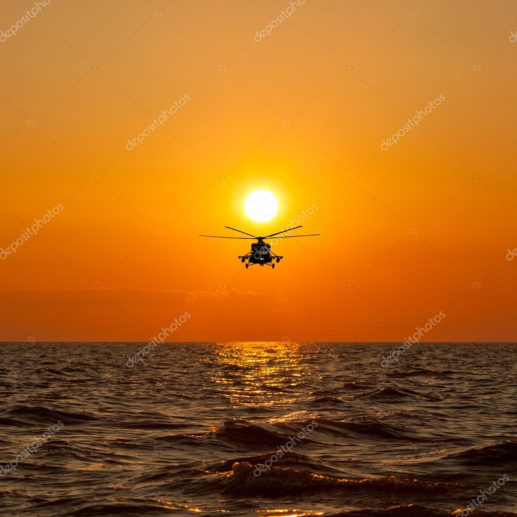 helicopter with warm sunset as background