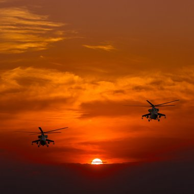 Mi-24 helicopters, warm sunset