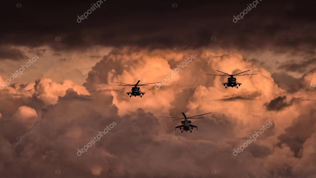 Group combat helicopters, Mi-24, Mi-8 on a background of clouds