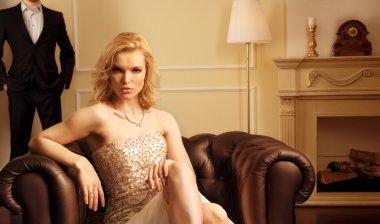 Luxury woman in rich interior