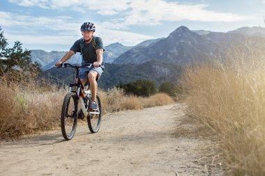 Man mountain biking