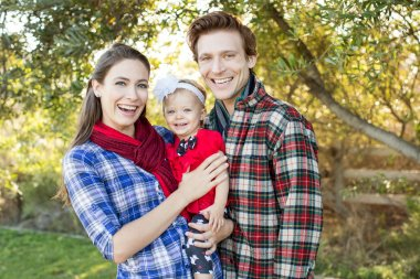 Young family in plaid shirts