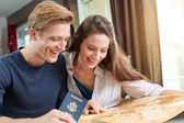 Fotografie Couple planning vacation