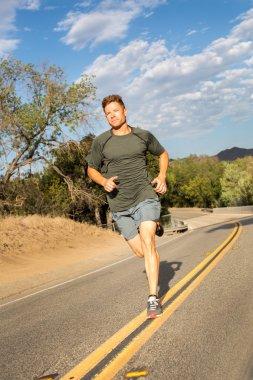 Man running on rural road