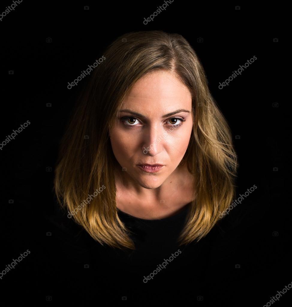 Dramatic woman on black