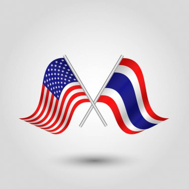 Vector two crossed american and thai flags on silver sticks - symbol of united states of america and thailan icon
