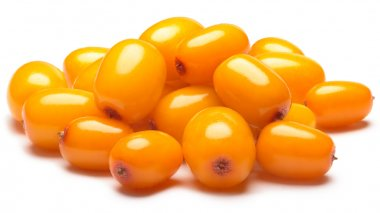 Pile of sea buckthorn berries, clipping paths