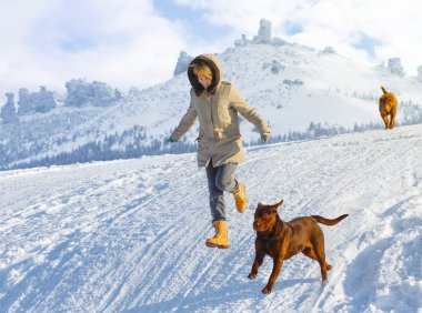 Woman jumping with dogs