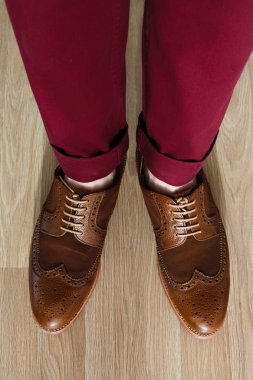 Sockless legs in pants and brogue