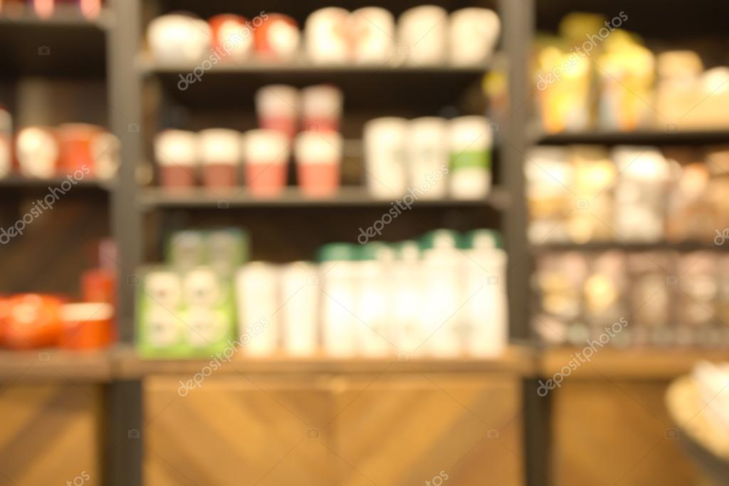 Abstract blurry retail store water glass shelf background — Stock
