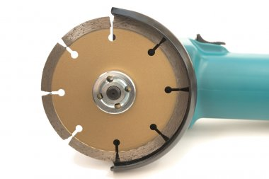 Closeup of Green color electrical metal grinder bottom showing stone grinder disc over white background