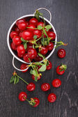 Fotografie Cherries in vintage colander