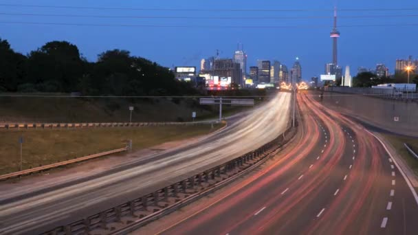 A timelapse view of night traffic moving around a long bend