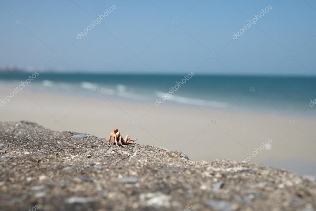 Miniature people on the beach
