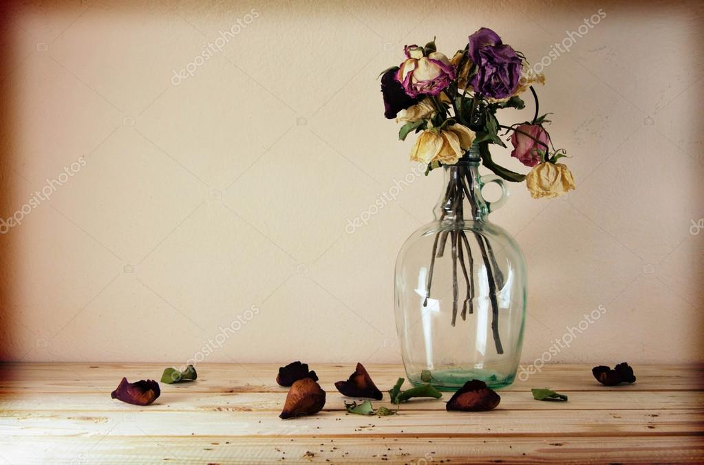 Still life with flowers on wooden table over grunge background,