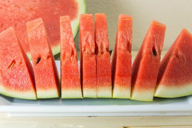 fresh watermelon sliced on wooden table. selective focus on fres