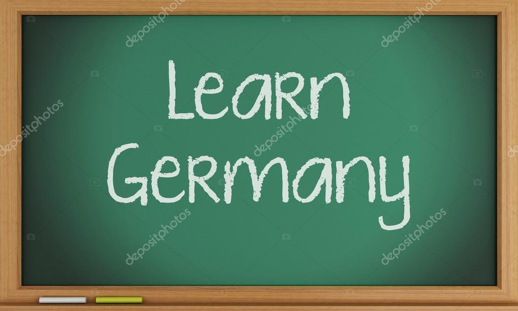 learn germany written on blackboard stock photo nicomenijes