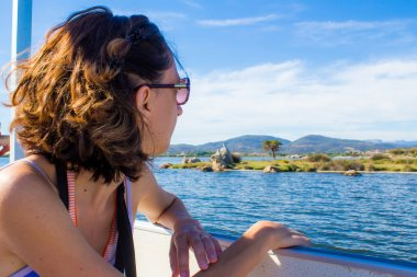 Woman on a boat looking out to sea