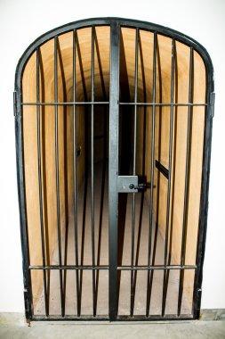 metal door with bars in a prison