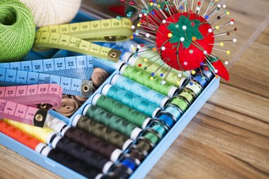 Sewing with color threads, meter and scissors