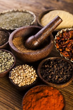 Spices and herbs in wooden bowls