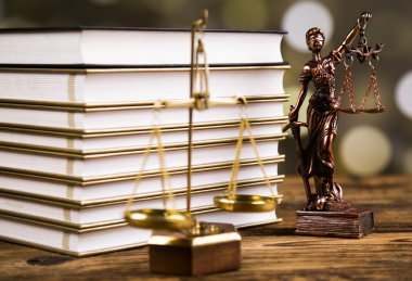 Golden scales of justice, books, Statue of Lady Justice. Owl and paragraph
