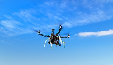 Flying multicopter with camera in brushless gimbal and autopilot