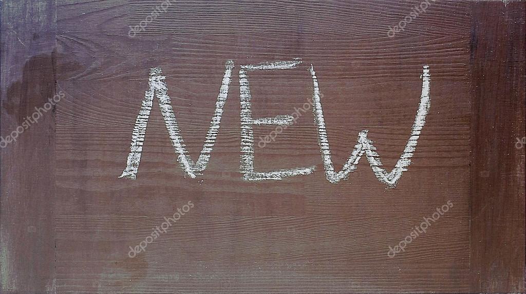 Hand Written New Word On Dark Wooden Chalkboard Background Stock Photo