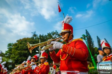 Ho Chi Minh city, Vietnam - 24 Jan 2021: Vo Thanh Trang marching band playing musicians, instruments in Tet Viet holidays (Tet festival 2021) in Vietnam