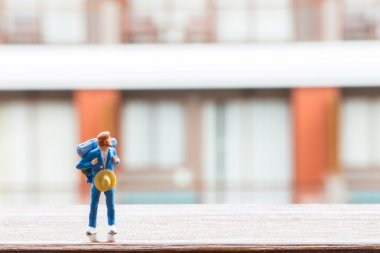Mini Figure of traveller with window hotel background
