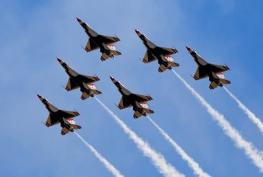 Smoke from army jets flying at airshow