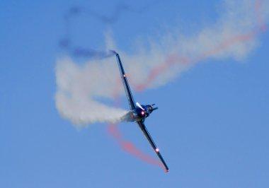 Acrobatic plane doing loops