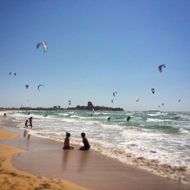 Kitesurfing competition on beach