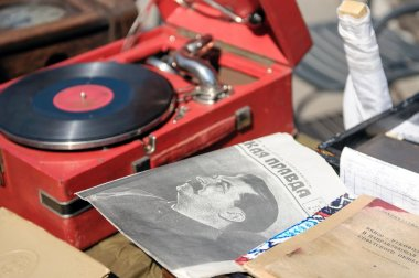Gramophone and old newspapers