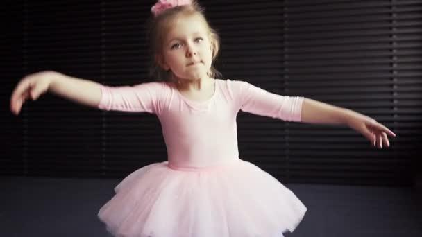 Child Little ballerina in pink tutu dancer. Childrens ballet. Slow motion.