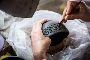 Hand Carving clay for make earthenware.