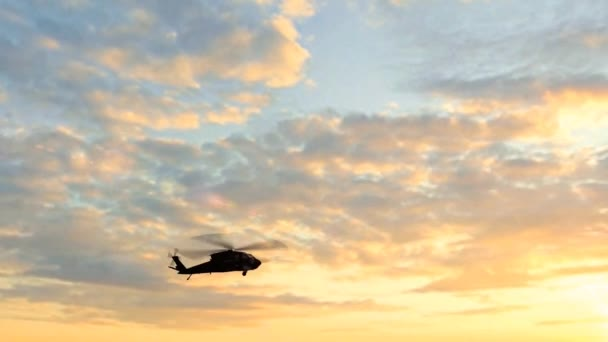 Black Hawk Helicopter Take Off silhouette in the sunse
