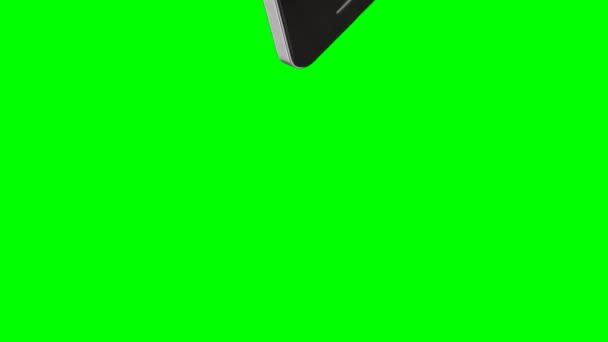 Smartphone narazí na zeleném pozadí