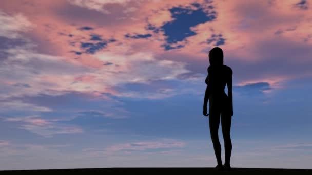 Sagoma di donna ragazza nel tramonto