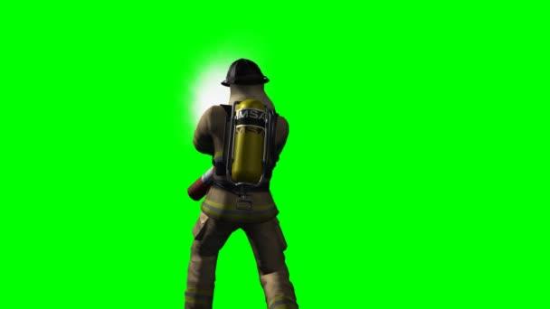 Hasič v akci na zeleném pozadí