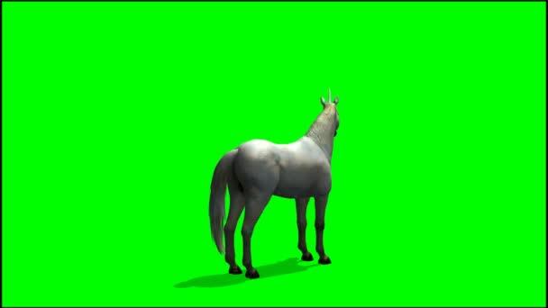 Jednorožec, rozhlížel na zeleném pozadí
