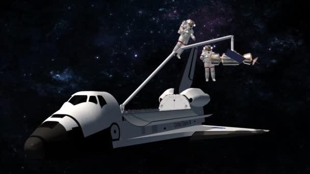 Astronauti raketoplánu pracují na satelitu