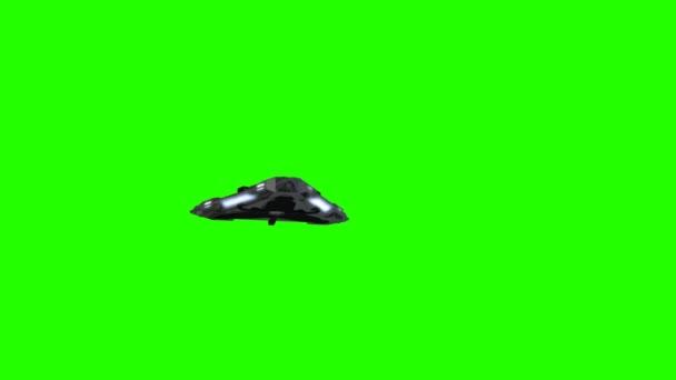 Létající talíř na zeleném pozadí