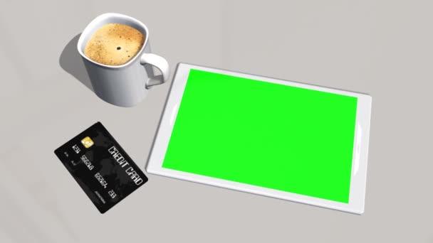 Tábla-PC, bankkártya az asztalnál