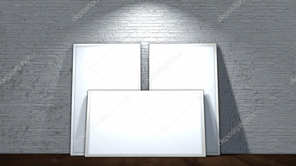 three blank screen frames on old brick wall and wooden floor ...