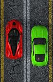 Photo two luxury Sports Cars on sphalt street - top view